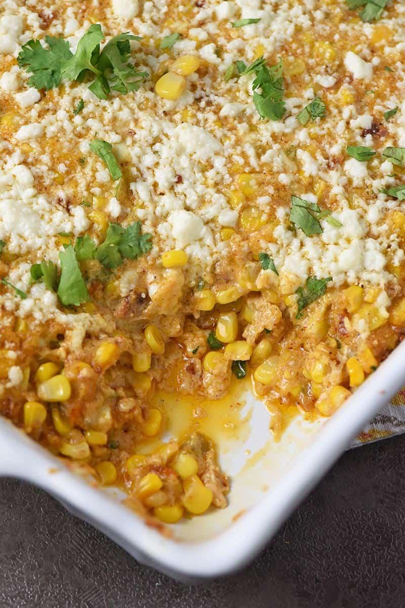 easy Mexican corn casserole in a white baking dish with cilantro