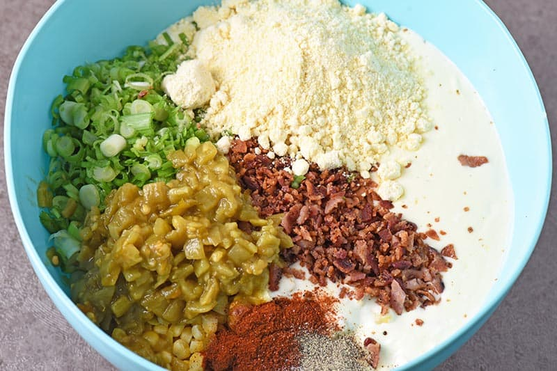 ingredients for baked Mexican corn casserole in mixing bowl