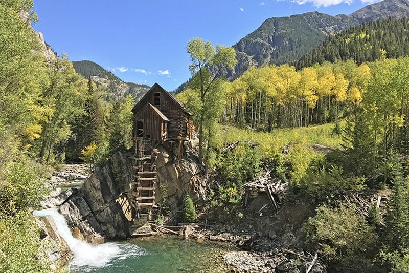 Crystal Mill and the Crystal River Colorado with golden yellow aspens in autumn