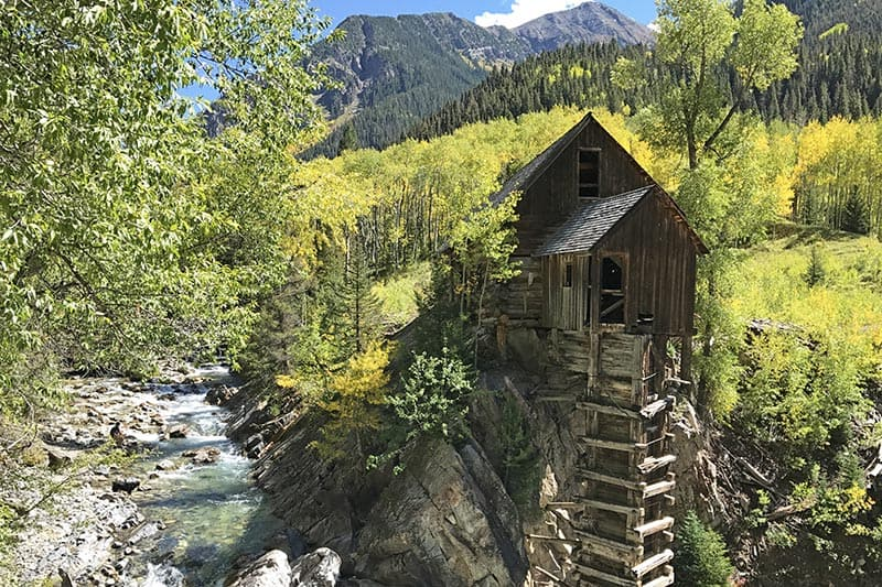 gorgeous Crystal Mill surrounded by yellow aspens in Colorado