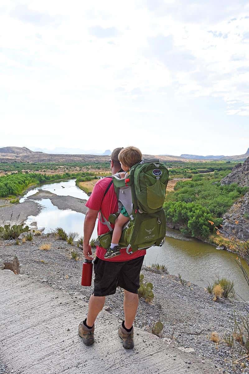 dad with toddler in hiking carrier enjoying a view of Big Bend from Santa Elena Canyon Trail
