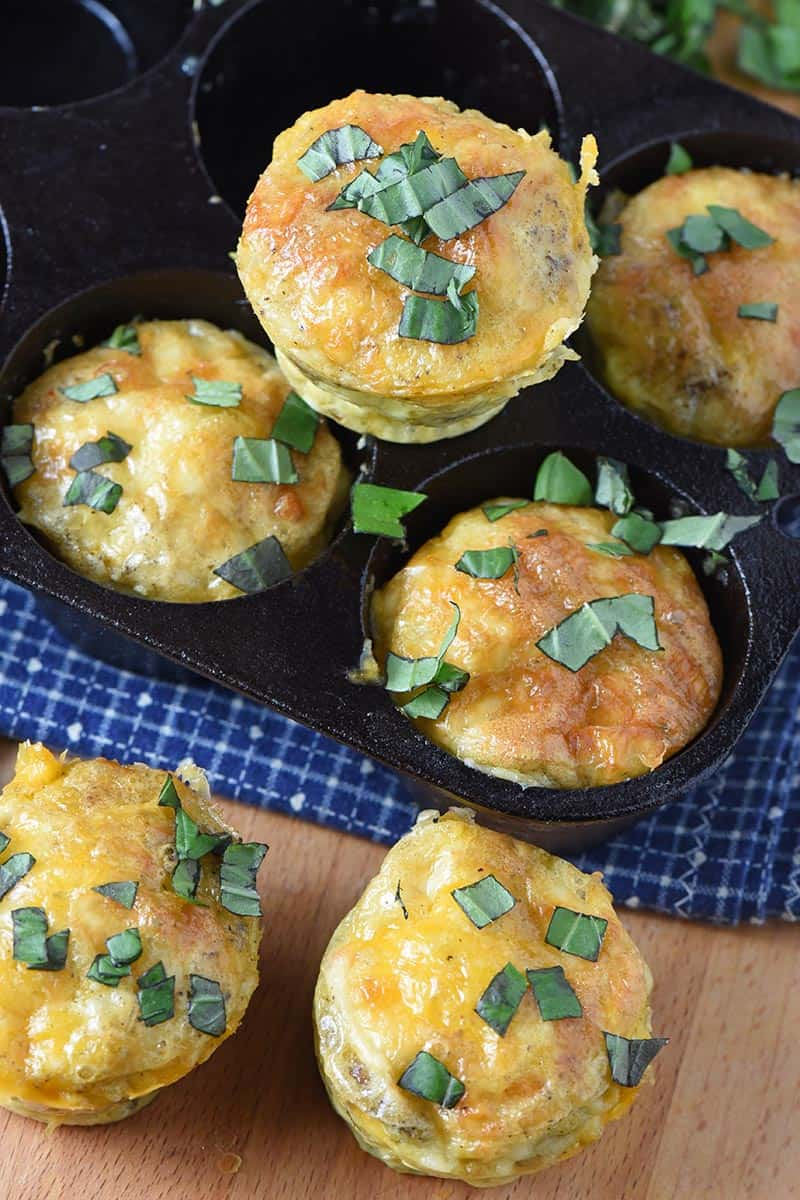 sausage egg muffins popped out of muffin tin, ready to eat for an easy breakfast