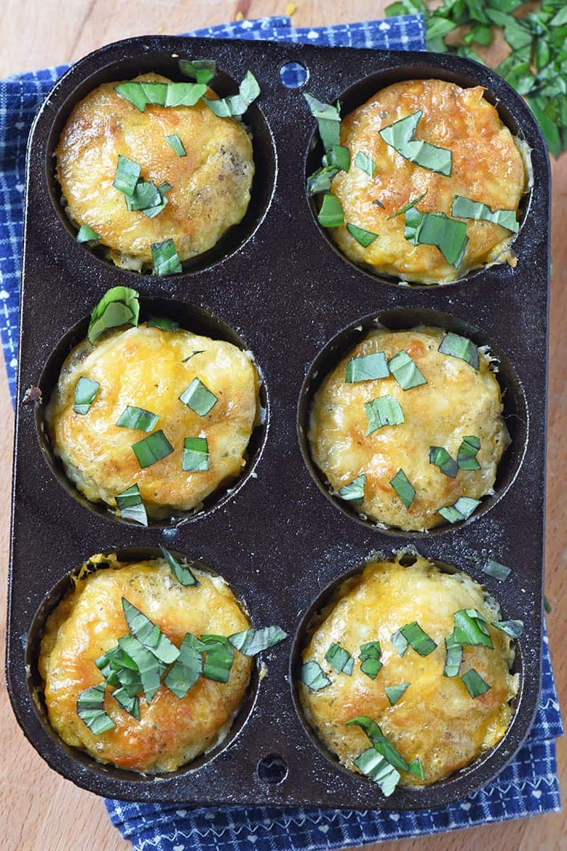 sausage egg muffins in a cast iron muffin tin