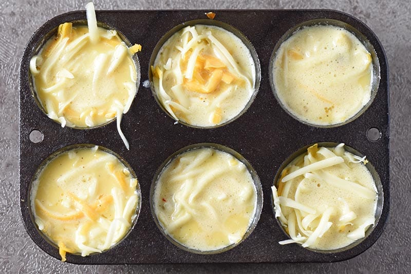 fill egg cups with egg mixture for easy sausage egg muffins