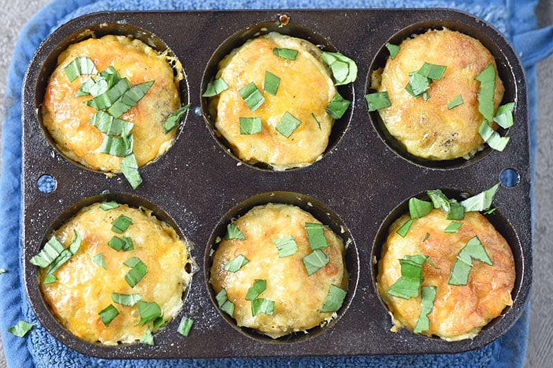 cooked sausage egg muffins in cast iron muffin pan
