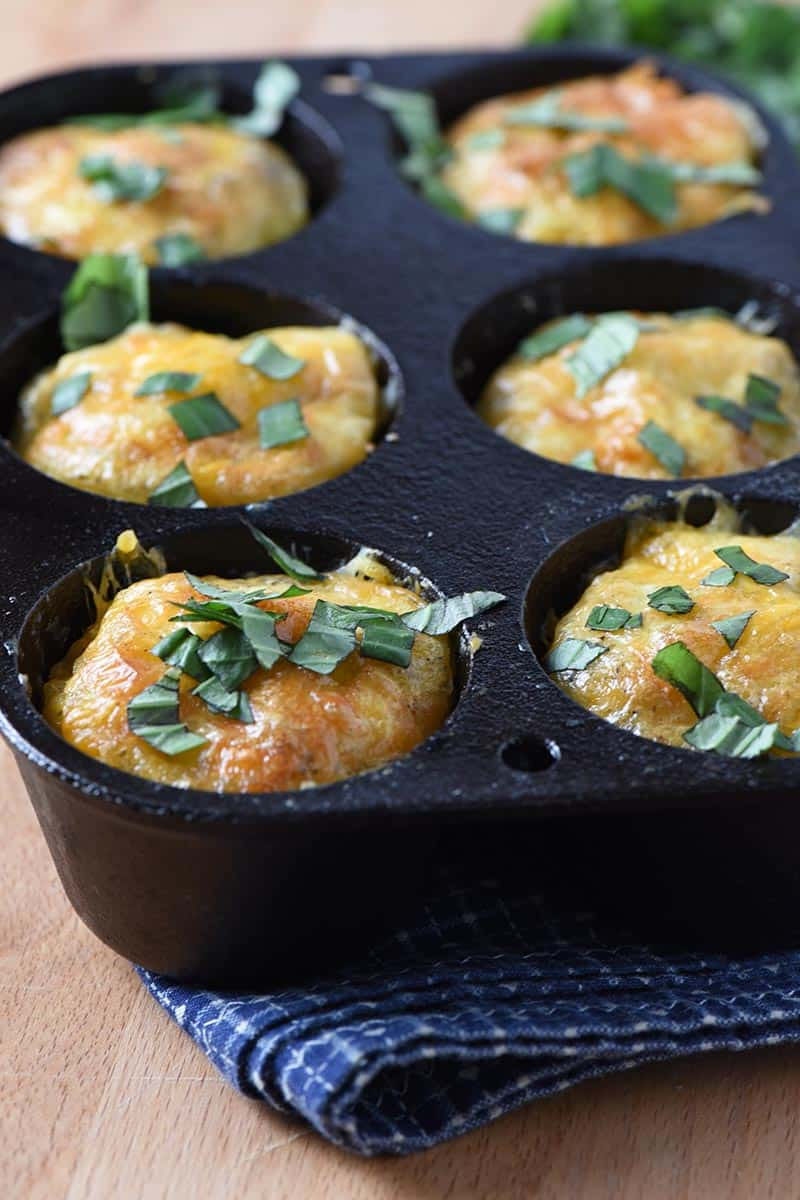 low carb sausage egg muffins in a muffin pan