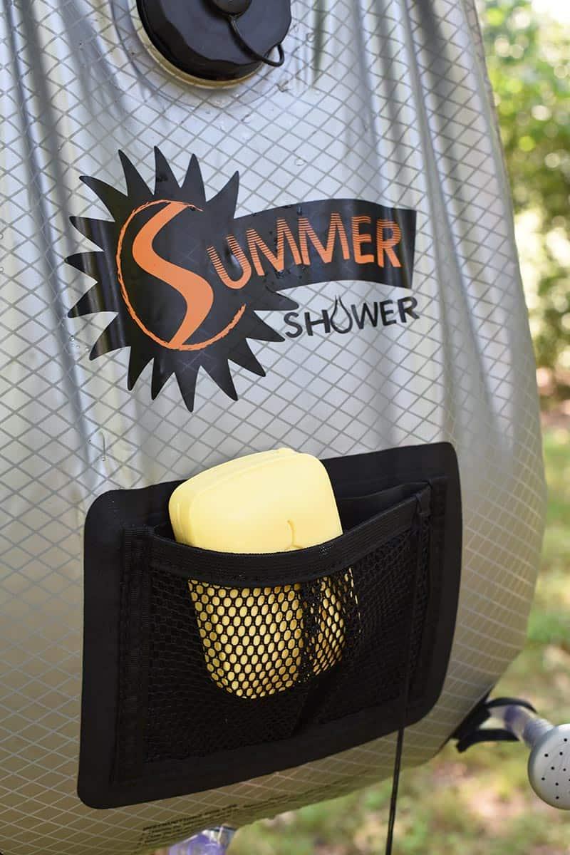 soap holder pocket on outdoor shower for camping