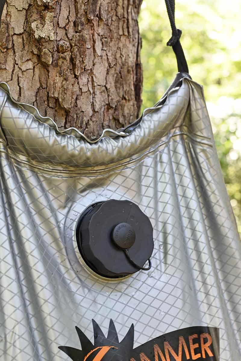 handy filling valve on solar shower for camping
