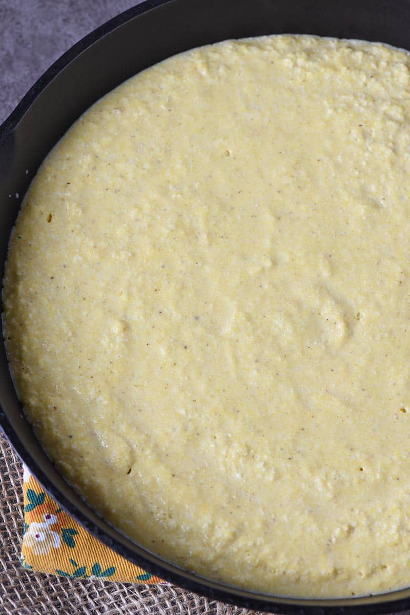 buttermilk cornbread batter in cast iron skillet