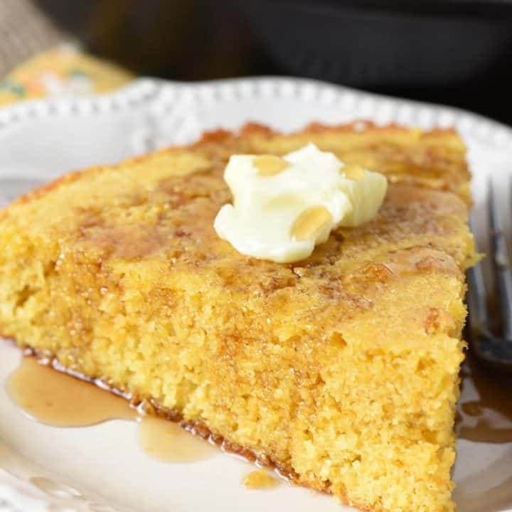 buttermilk cornbread with butter and maple syrup on white Pioneer Woman plate