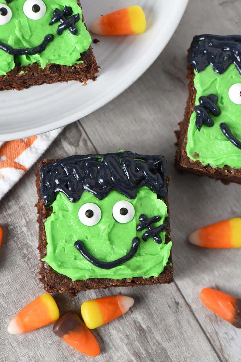 Frankenstein Halloween Brownies decorated for Halloween treats on wood with candy corn
