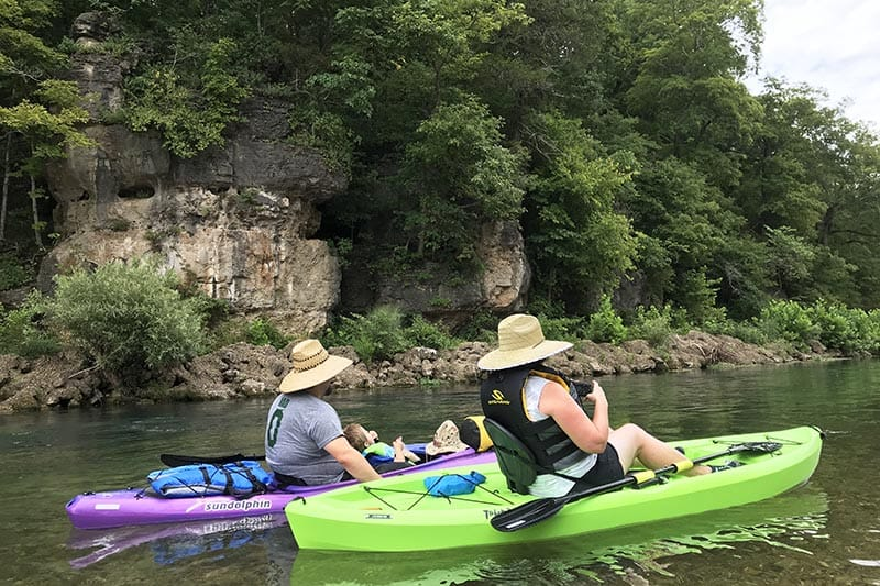 kayaking next to a bluff on the Jacks Fork River from Alley Spring to Eminence, MO