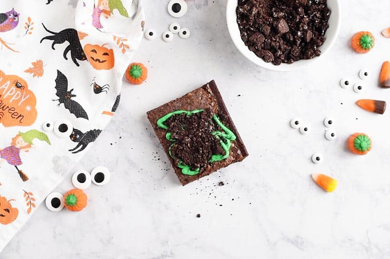 crushed Oreos for dirt on graveyard halloween brownies