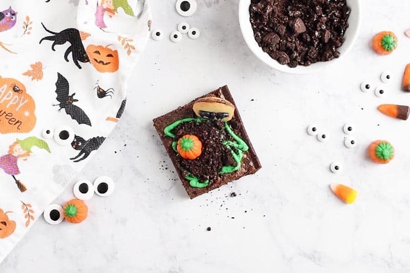 put Milano Cookie gravestone and candy corn pumpkin on graveyard halloween brownies