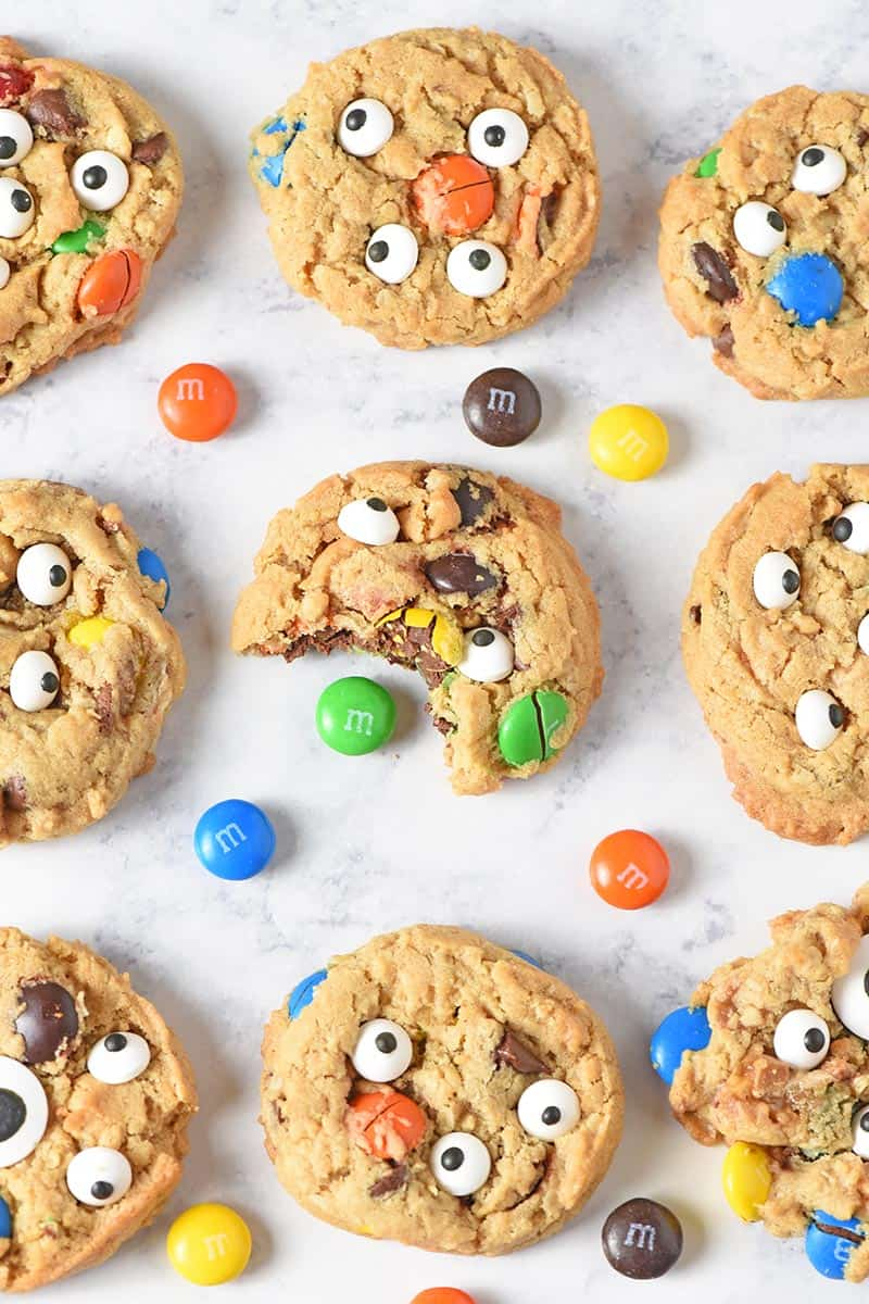 monster cookies with M&M'S candies on white marble countertop