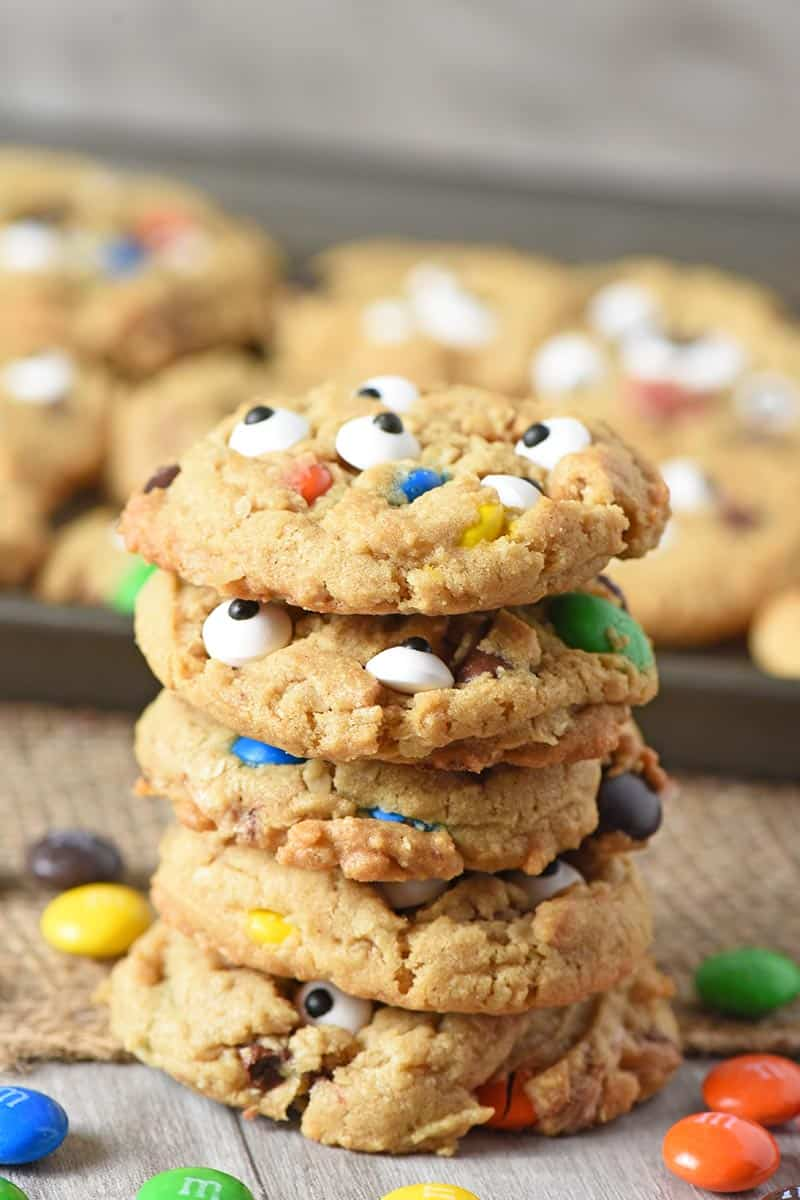 stack of monster cookies made with halloween candy and candy eyeballs