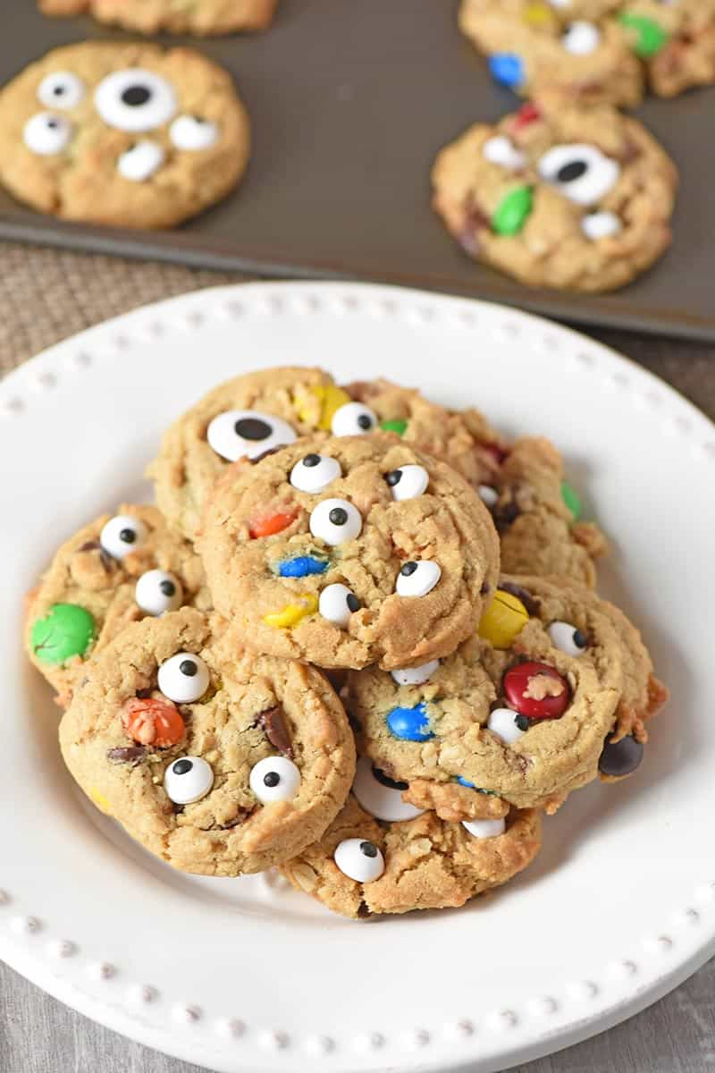 pile of Halloween monster cookies on a white plate