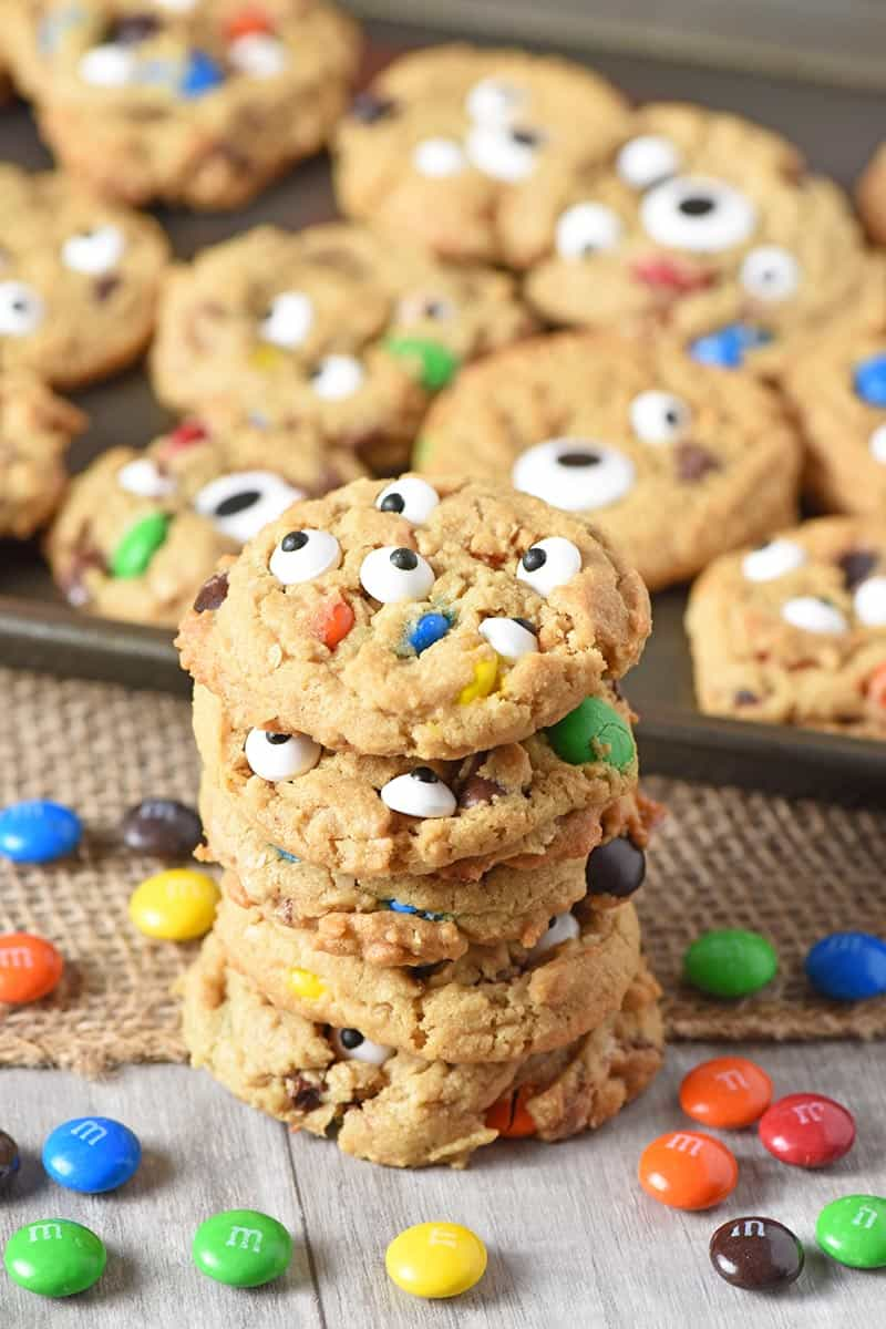 stack of monster cookies made with M&M'S and Halloween candy