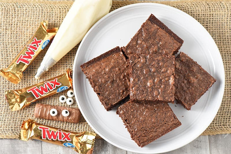 ingredients to make cute Halloween treats, Twix bar mummy Halloween brownies