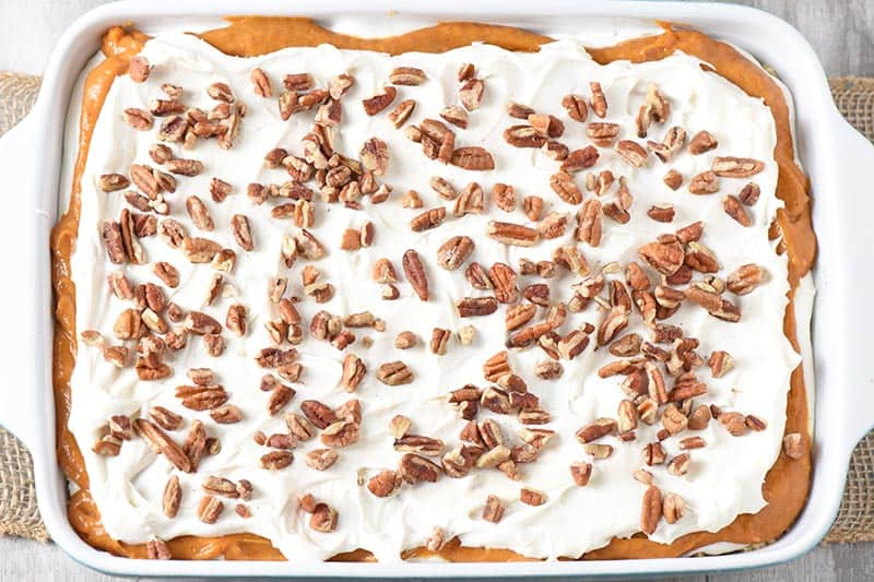 no bake pumpkin dessert with chopped pecans on top