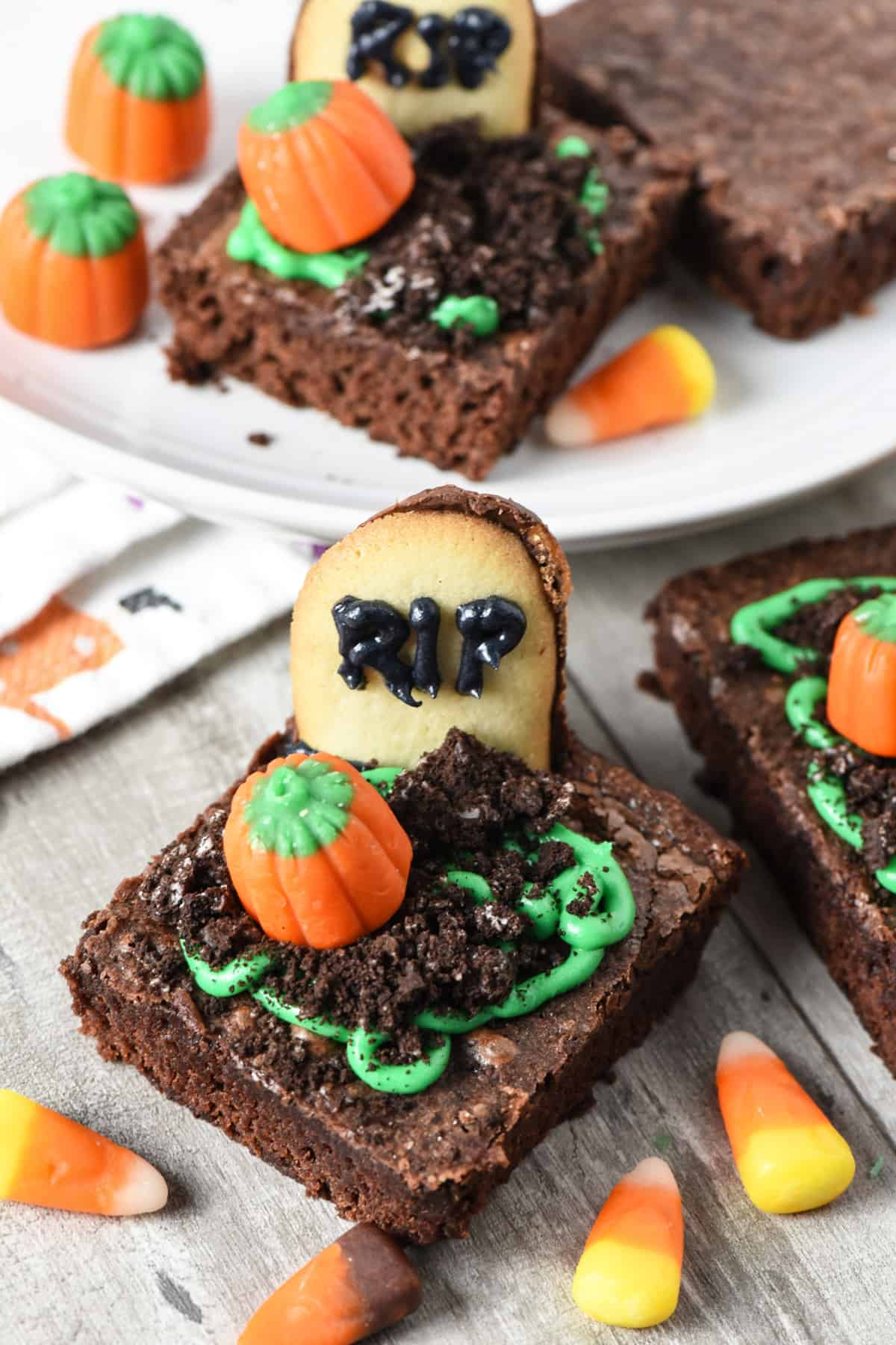 tombstone brownies with candy corn on wood countertop