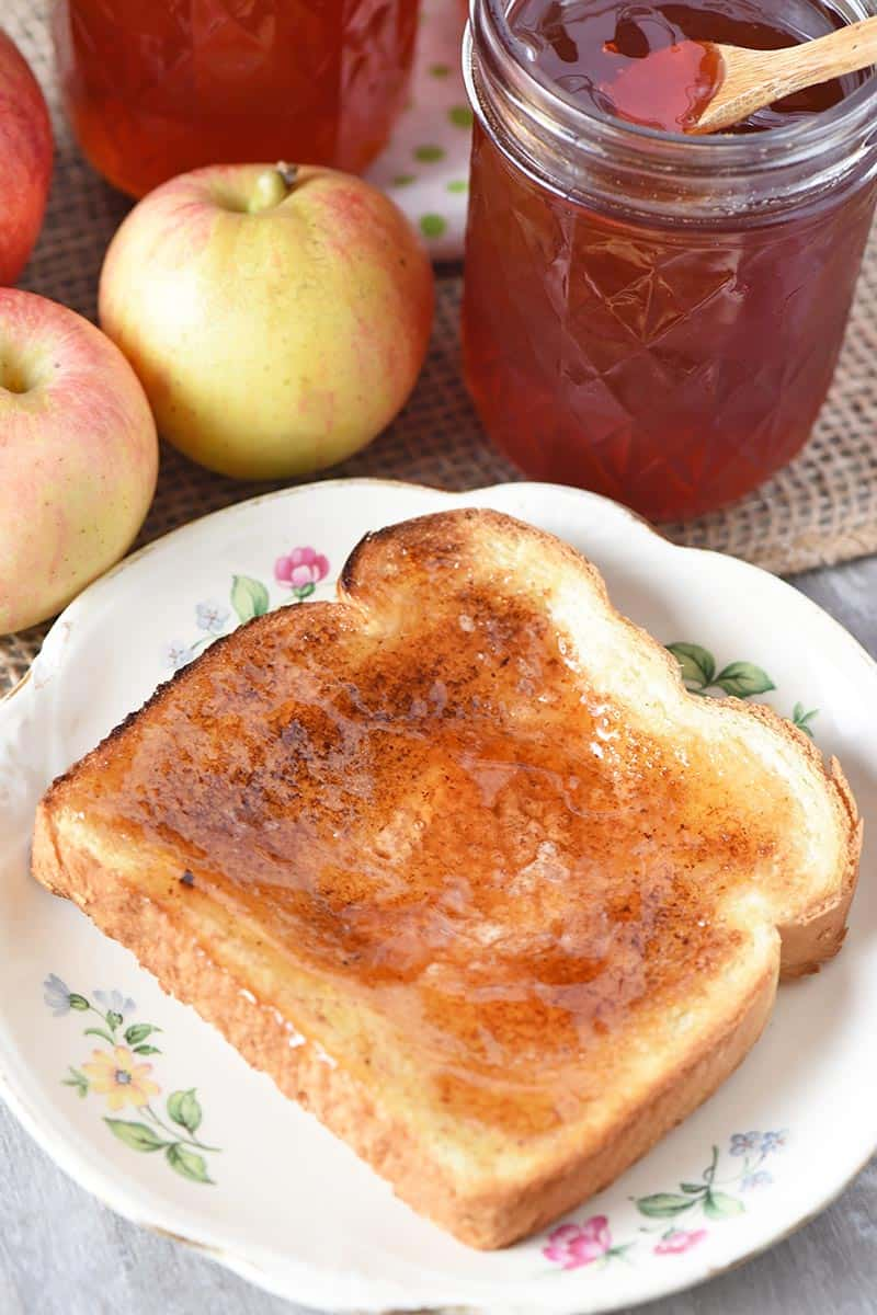 Gala apple jelly on toast on white flowered plate for breakfast