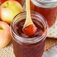 spooning apple jelly out of a jelly jar