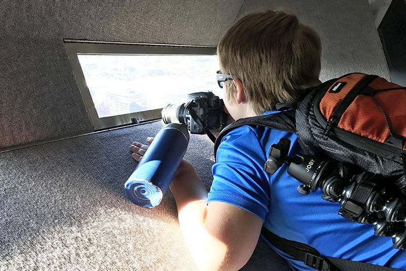 boy enjoying the view of St. Louis from the top of the Arch