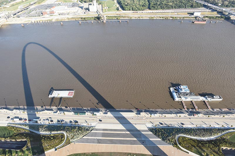 view of the Mississippi River with an Arch shadow from the top of the Gateway Arch
