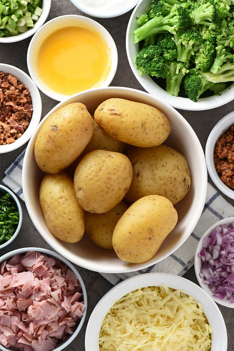 baked potato bar with baked potatoes and baked potato toppings