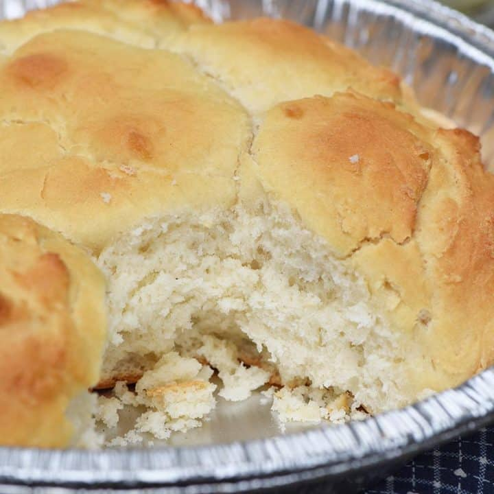 fluffy campfire drop biscuits in a tin foil pie plate