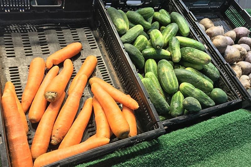carrots, cucumbers, and potatoes at Soulard Market, St. Louis Farmer's Market in Missouri