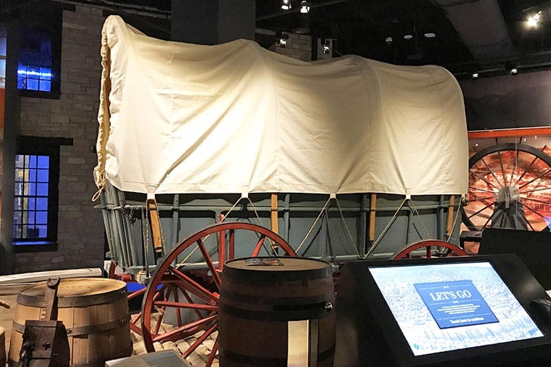 covered wagon exhibit in the Gateway Arch Museum in St. Louis, Missouri