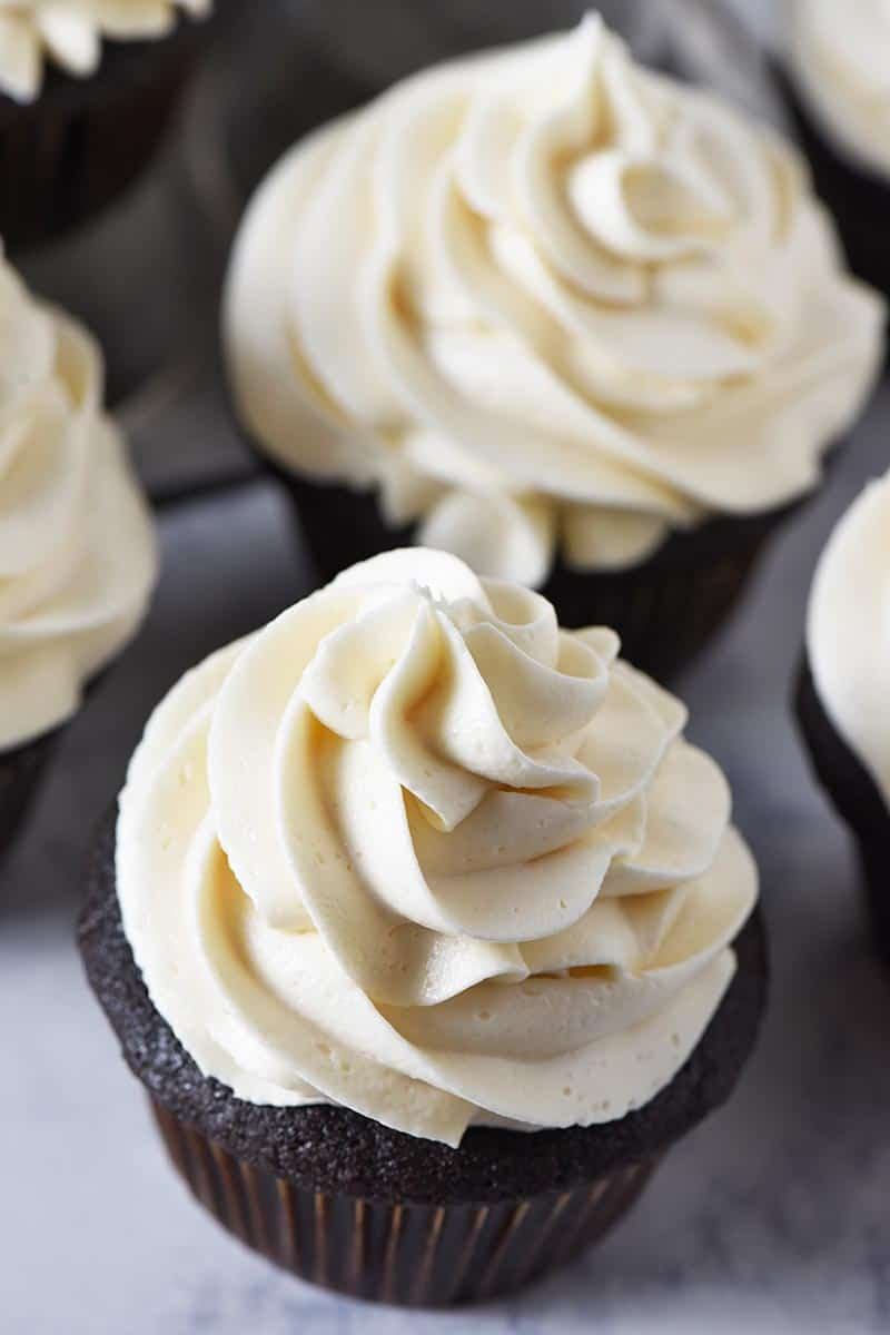 chocolate cupcakes topped with swirls of creamy butterbeer buttercream frosting