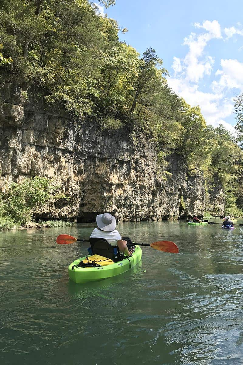 kayakers kayaking past bluffs on the Current River from Akers Ferry to Pulltite Campground