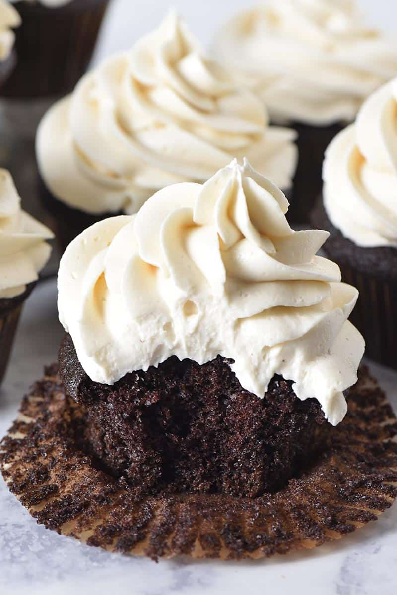 bite out of moist and fluffy chocolate cupcakes with butterbeer buttercream frosting