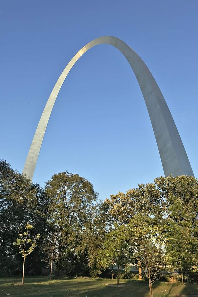 Gateway Arch National Park with tree lined pathways and grassy knolls in St. Louis, Missouri