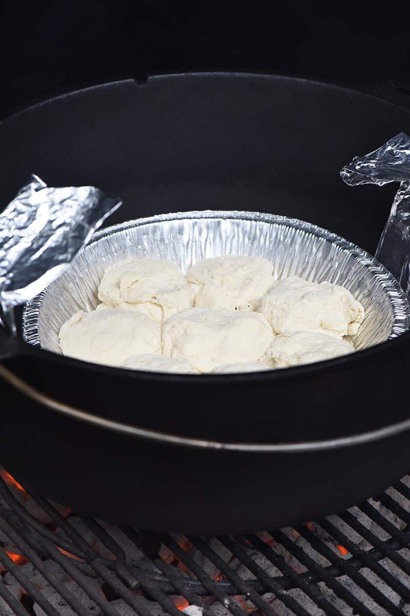 grilling Dutch oven drop biscuits while camping
