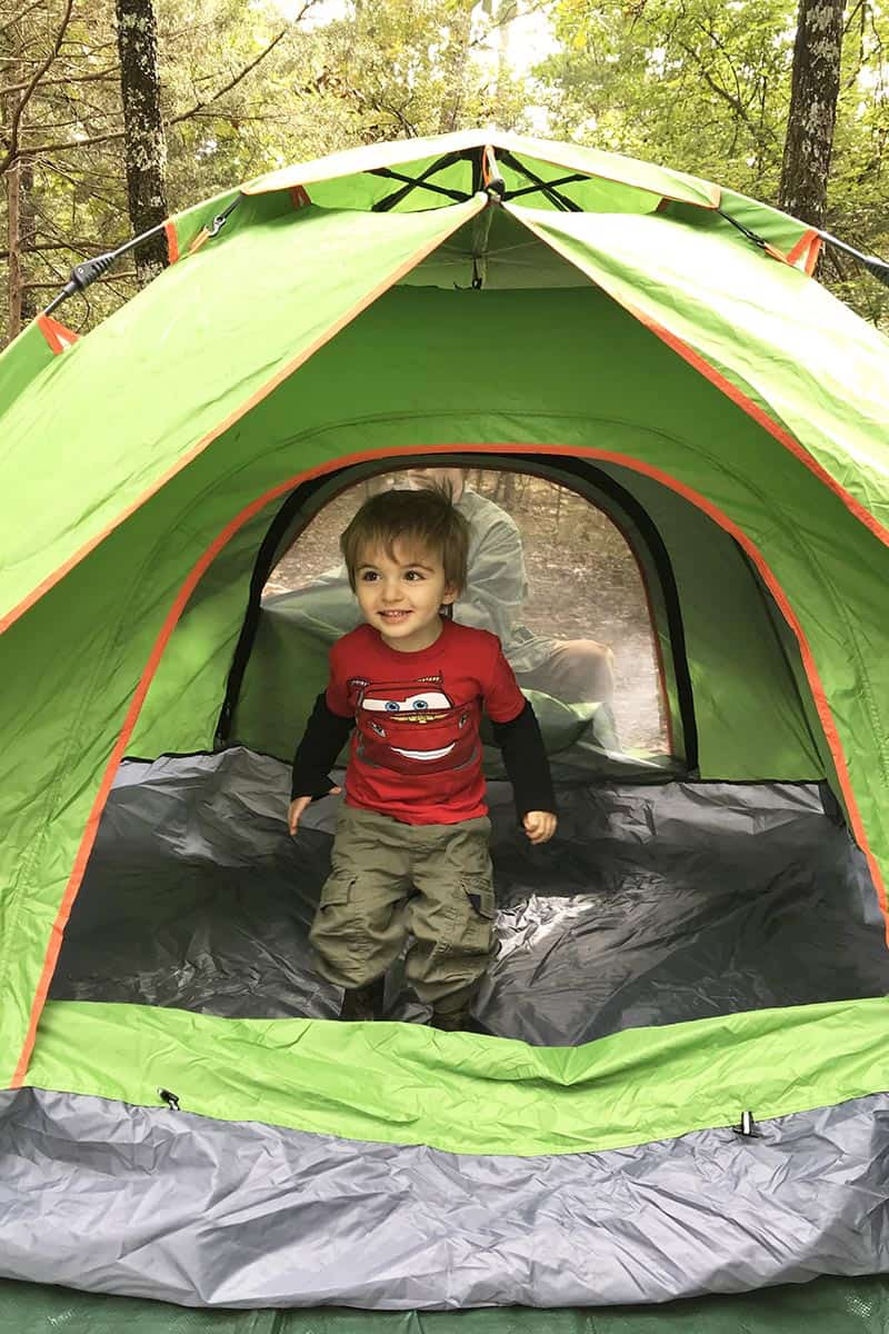 toddler in ground tent in Petit Jean State Park campsite