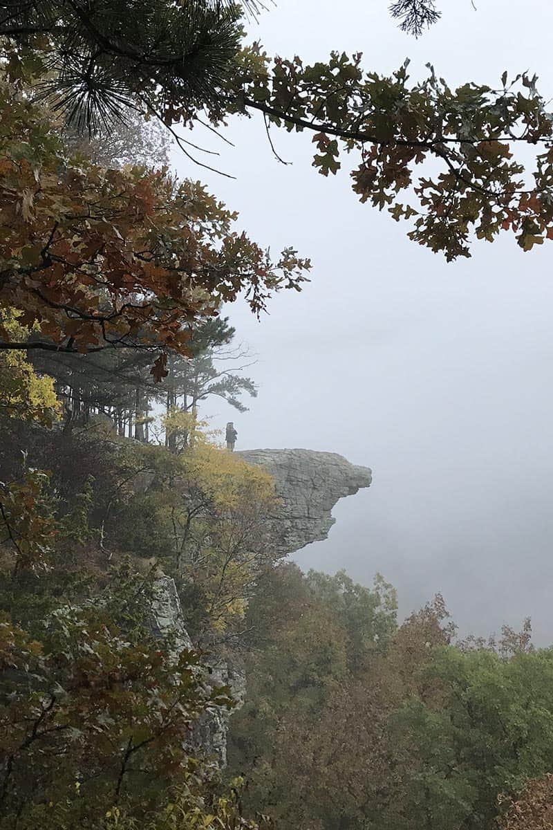 man on Hawksbill Crag from afar, Whitaker Point Trail in Arkansas