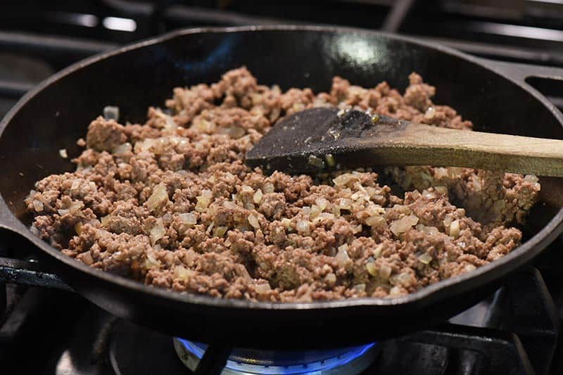 cooking ground beef mixture for sloppy joes in cast iron skillet