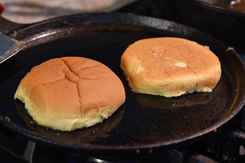 toasting hamburger buns in a little bit of bacon grease on cast iron griddle for the most delicious sloppy joes