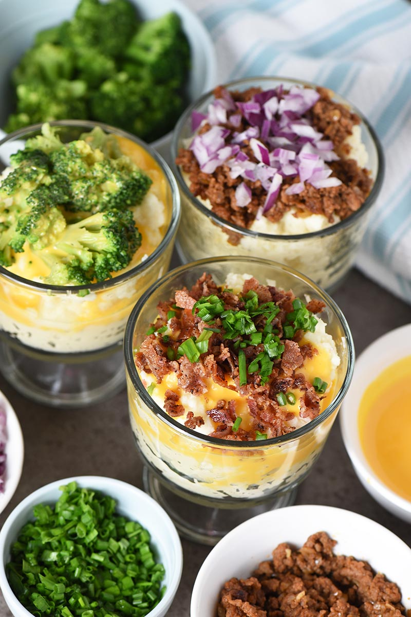 mashed potato bar toppings with small glass trifle bowls of mashed potatoes