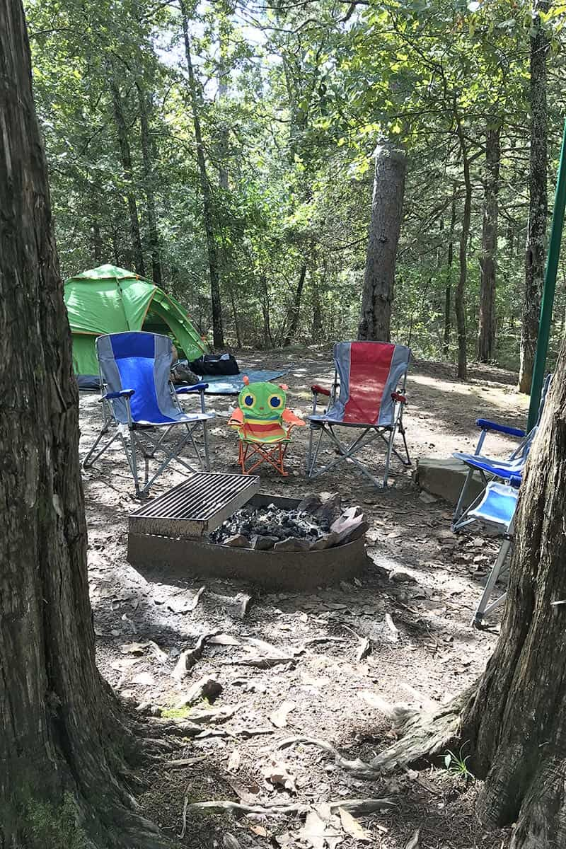 campsite with fire ring and camping chairs at Petit Jean State Park
