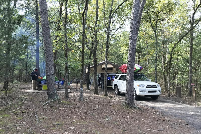 campsite with rooftop tent at Petit Jean State Park, one of our favorite Arkansas state parks