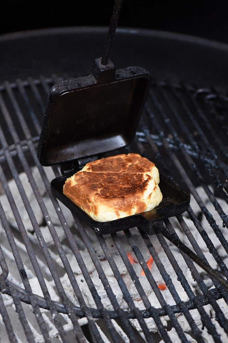 pie iron recipe for drop biscuits and cooking drop biscuits in a pie iron for campfire food