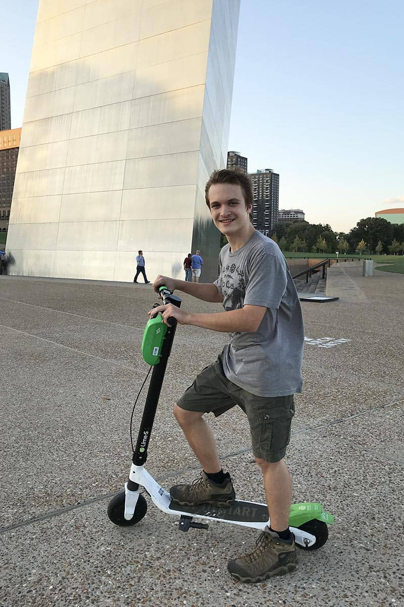 teen riding scooters in Gateway Arch National Park in St. Louis, Missouri