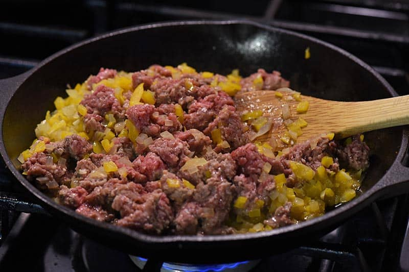 ground beef mixture for taco sloppy joes cooking in cast iron skillet on stovetop