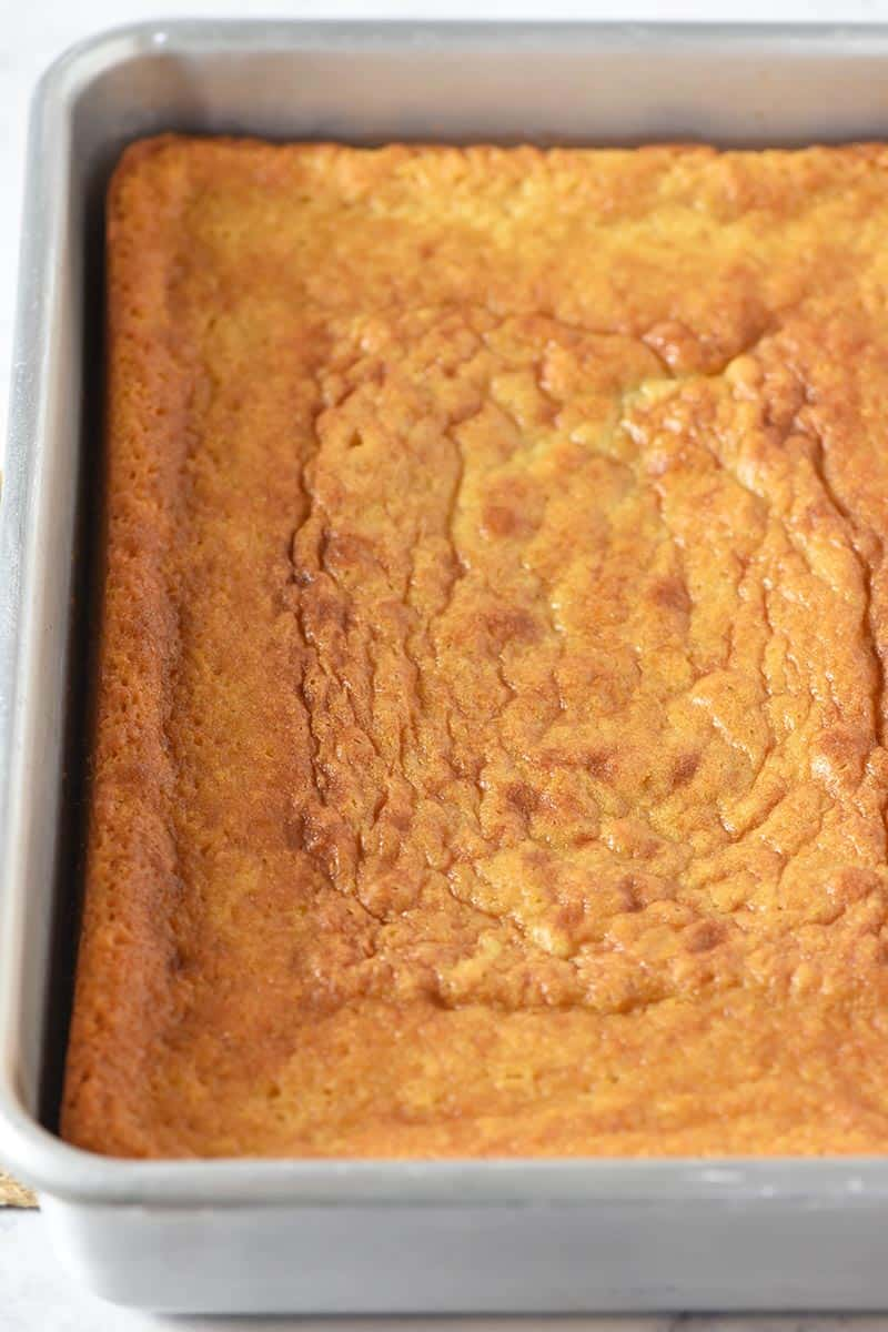 baked yellow cake cooling in metal cake pan