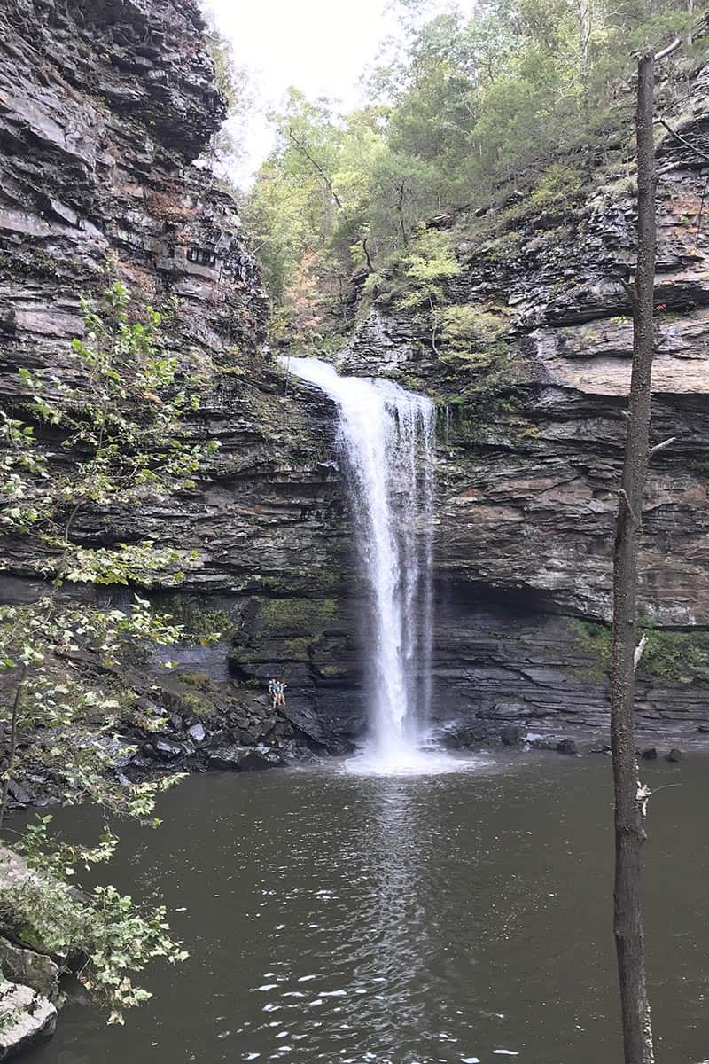 people standing beside Cedar Falls in Petit Jean State Park in Arkansas
